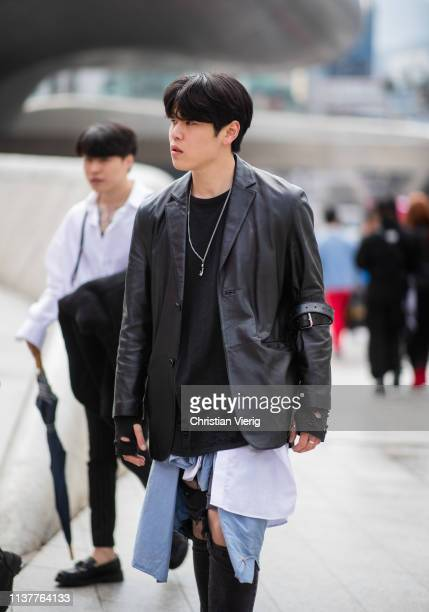 A guest is seen wearing black leather jacket denim jeans at the Hera Seoul Fashion Week 2019 F/W at Dongdaemun Design Plaza at Dongdaemun Design...
