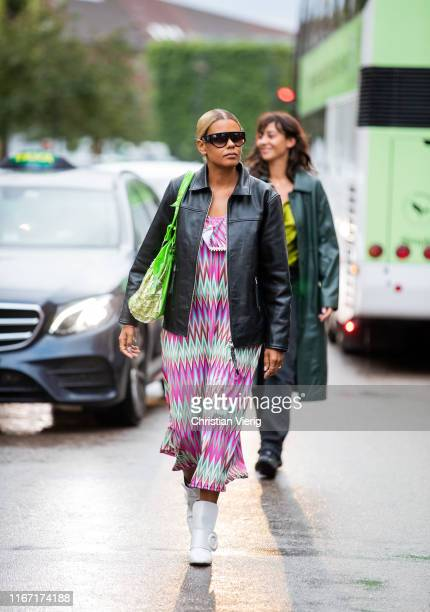 A guest is seen wearing black leather jacket dress with print outside Saks Potts during Copenhagen Fashion Week Spring/Summer 2020 on August 08 2019...