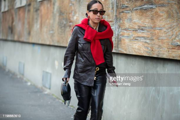 A guest is seen wearing black leather pants button up shirt outside Marni during Milan Men Fashion Week Fall Winter 2020/2021 on January 11 2020 in...