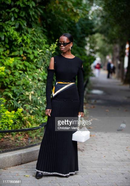 Guest is seen wearing black pleated pants, Loewe scarf outside Issey Miyake during Paris Fashion Week Womenswear Spring Summer 2020 on September 27,...