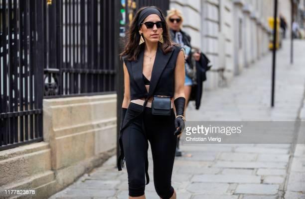 Guest is seen wearing black sleeveless cropped blazer, gloves outside Altuzarra during Paris Fashion Week Womenswear Spring Summer 2020 on September...