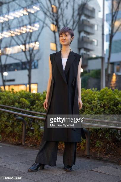Guest is seen wearing black sleeveless dress with black pants and shoes during the Amazon Fashion Week TOKYO 2019 A/W on March 18, 2019 in Tokyo,...