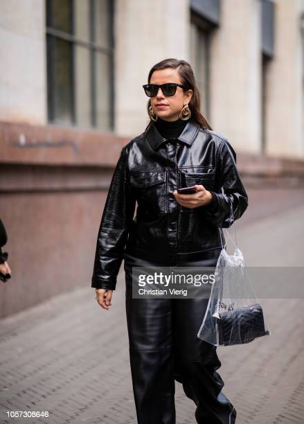 Guest is seen wearing black vinyl jacket and pants during Mercedes-Benz Tbilisi Fashion Week on November 4, 2018 in Tbilisi, Georgia.