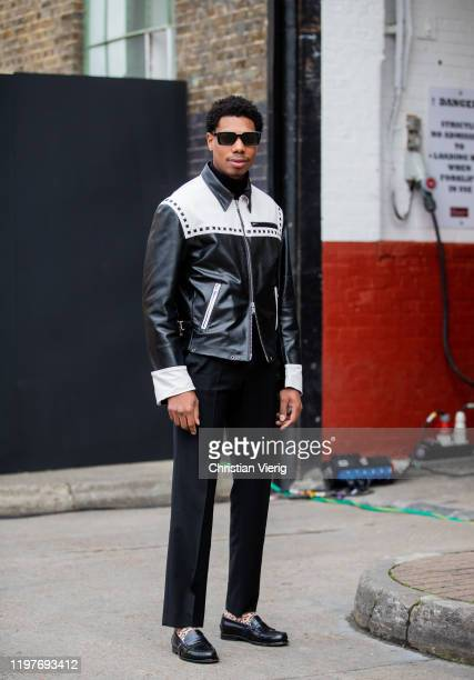 A guest is seen wearing black white jacket during London Fashion Week Men's January 2020 on January 05 2020 in London England
