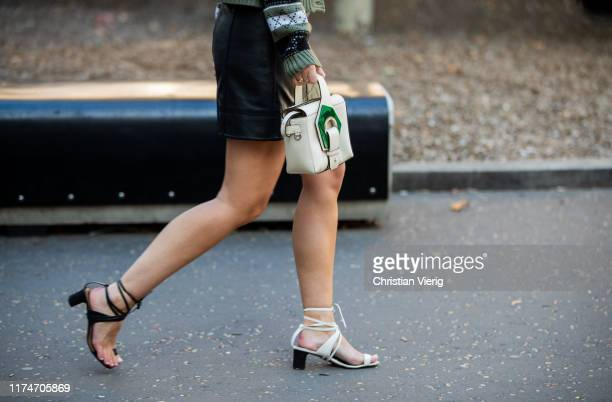 A guest is seen wearing black white twon tone sandals white green bag outside Ports 1961 during London Fashion Week September 2019 on September 14...