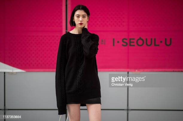 A guest is seen wearing blak knit at the Hera Seoul Fashion Week 2019 F/W at Dongdaemun Design Plaza at Dongdaemun Design Plaza on March 21 2019 in...