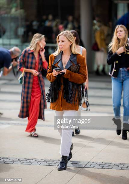 A guest is seen wearing blazer vest with fringes outside Tory Burch during New York Fashion Week September 2019 on September 08 2019 in New York City