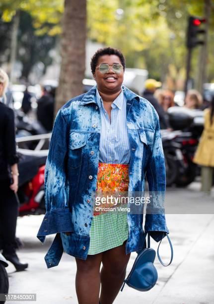 Guest is seen wearing blue batik button shirt outside Miu Miu during Paris Fashion Week Womenswear Spring Summer 2020 on October 01, 2019 in Paris,...