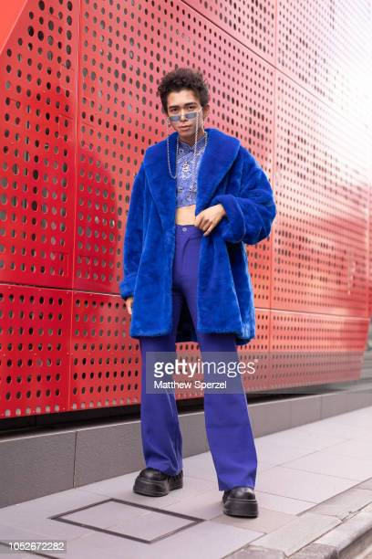 A guest is seen wearing blue fur coat cobalt pants blue crop top and black platform shoes during the Amazon Fashion Week TOKYO 2019 S/S on October 20...