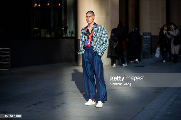 A guest is seen wearing blue pants checked blazer shirt with pattern and colors outside Edward Crutchley during London Fashion Week Men's January...
