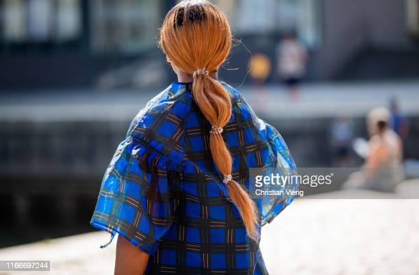 Guest is seen wearing blue plaid dress, pigtail outside Rodebjer during Copenhagen Fashion Week Spring/Summer 2020 on August 07, 2019 in Copenhagen,...