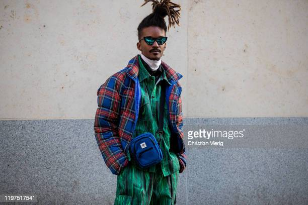 A guest is seen wearing blue red checked down feather jacket outside Edward Crutchley during London Fashion Week Men's January 2020 on January 04...