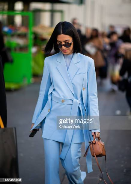 A guest is seen wearing blue suit outside Marques Almeida during Paris Fashion Week Womenswear Fall/Winter 2019/2020 on February 26 2019 in Paris...