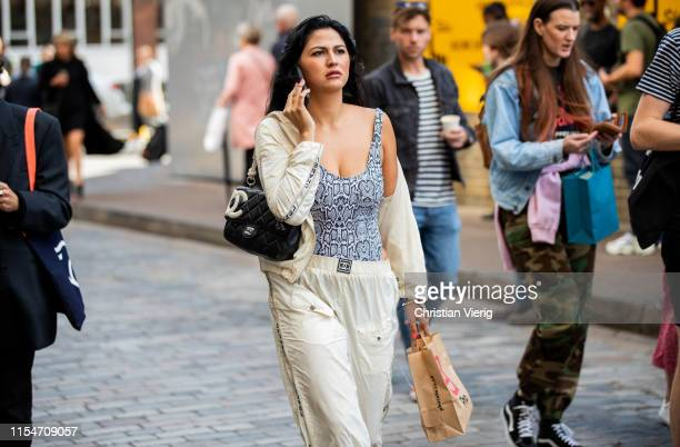 A guest is seen wearing body with snake print outside Iceberg during London Fashion Week Men's June 2019 on June 08 2019 in London England