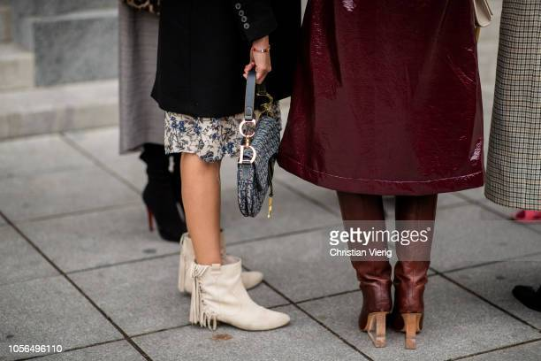 A guest is seen wearing boots with fringes Dior saddle bag during MercedesBenz Tbilisi Fashion Week on November 2 2018 in Tbilisi Georgia