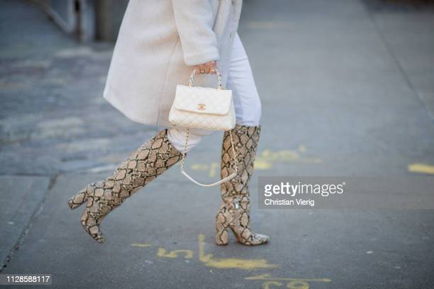 A guest is seen wearing boots with snake print outside SelfPortrait during New York Fashion Week Autumn Winter 2019 on February 09 2019 in New York...