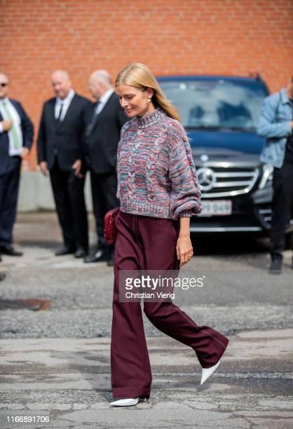 A guest is seen wearing bordeaux pants knit outside By Malene Birger during Copenhagen Fashion Week Spring/Summer 2020 on August 08 2019 in...
