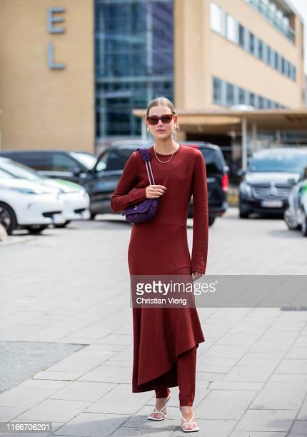 Guest is seen wearing boredeaux dress outside Holzweiler during Copenhagen Fashion Week Spring/Summer 2020 on August 07, 2019 in Copenhagen, Denmark.