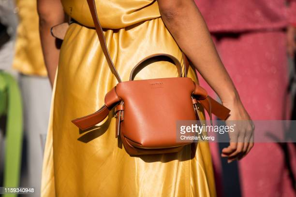 A guest is seen wearing brown bag Acne outside Acne during Paris Fashion Week Haute Couture Fall/Winter 2019/2020 on June 30 2019 in Paris France