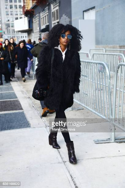 Guest is seen wearing brown black furs and sunglasses after Phillip Lim runway show during New York Fashion Week on February 13 2017 in New York City