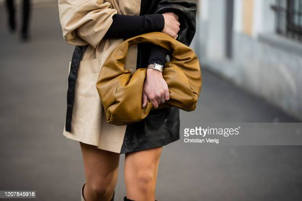 A guest is seen wearing brown Bottega Veneta bag outside Tods during Milan Fashion Week Fall/Winter 20202021 on February 21 2020 in Milan Italy