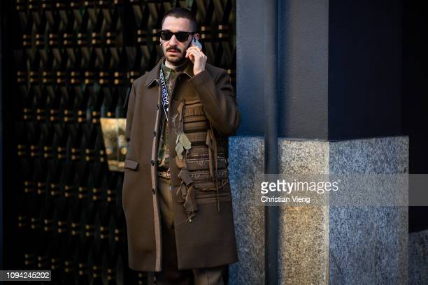 A guest is seen wearing brown coat and pants outside N21 during Milan Menswear Fashion Week Autumn/Winter 2019/20 on January 14 2019 in Milan Italy