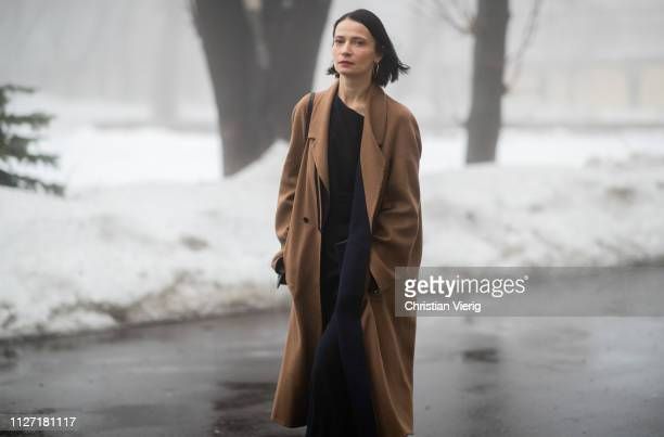 4182d131ed9 A guest is seen wearing brown coat during the Ukrainian Fashion Week 2019/20  on