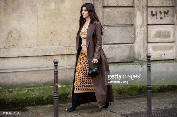 A guest is seen wearing brown coat net dress in camel Prada bag outside Altuzarra during Paris Fashion Week Womenswear Fall/Winter 2020/2021 Day Six...