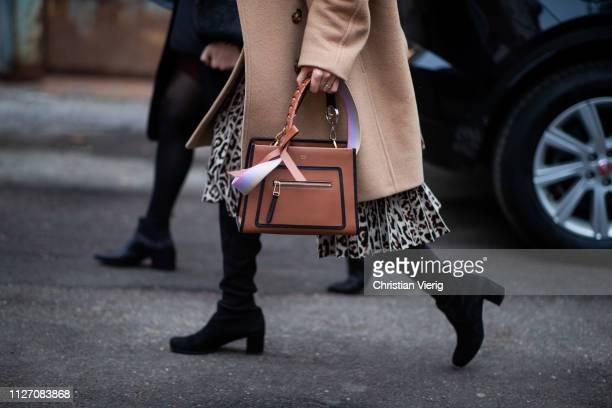 A guest is seen wearing brown Fendi bag outside Baum und Pferdgarten during the Copenhagen Fashion Week Autumn/Winter 2019 Day 3 on January 31 2019...