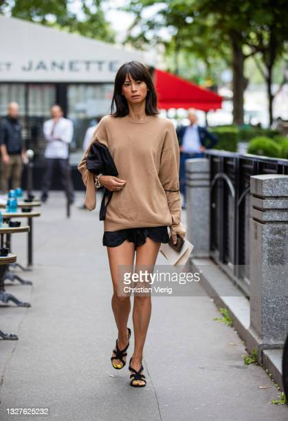 Guest is seen wearing brown jumper, heels, shorts, black bag outside Balenciaga on July 07, 2021 in Paris, France.