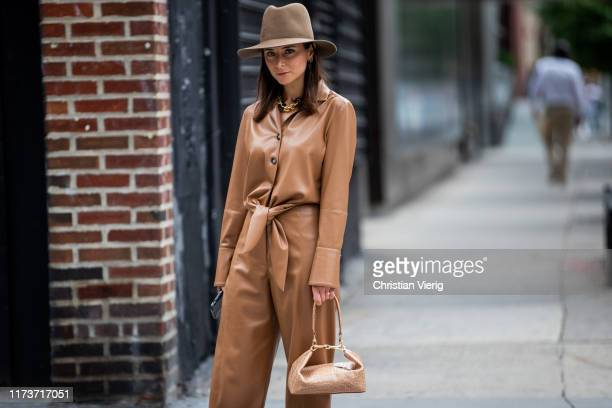 Guest is seen wearing brown overall, hat, bag outside Gabriela Hearst during New York Fashion Week September 2019 on September 10, 2019 in New York...