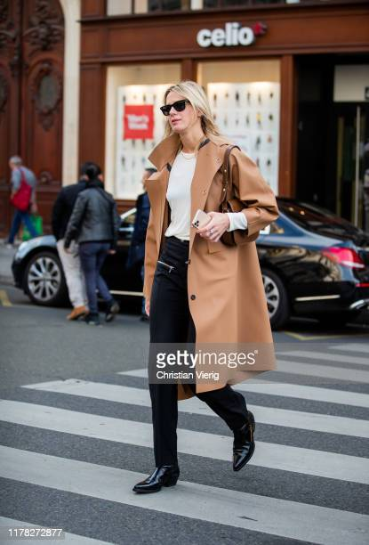 Guest is seen wearing brown trench coat outside Stella McCartney during Paris Fashion Week Womenswear Spring Summer 2020 on September 30, 2019 in...