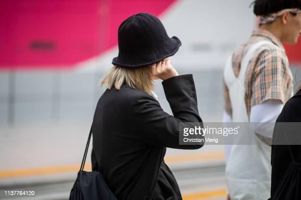 A guest is seen wearing bucket hat 2at the Hera Seoul Fashion Week 2019 F/W at Dongdaemun Design Plaza at Dongdaemun Design Plaza on March 23 2019 in...