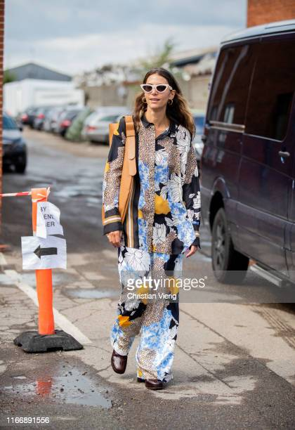 Guest is seen wearing button shirt and pants with graphic print outside By Malene Birger during Copenhagen Fashion Week Spring/Summer 2020 on August...
