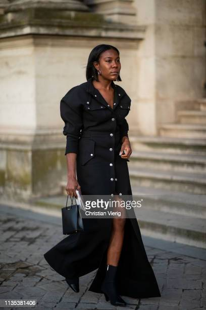 A guest is seen wearing button up dress outside Louis Vuitton during Paris Fashion Week Womenswear Fall/Winter 2019/2020 on March 05 2019 in Paris...