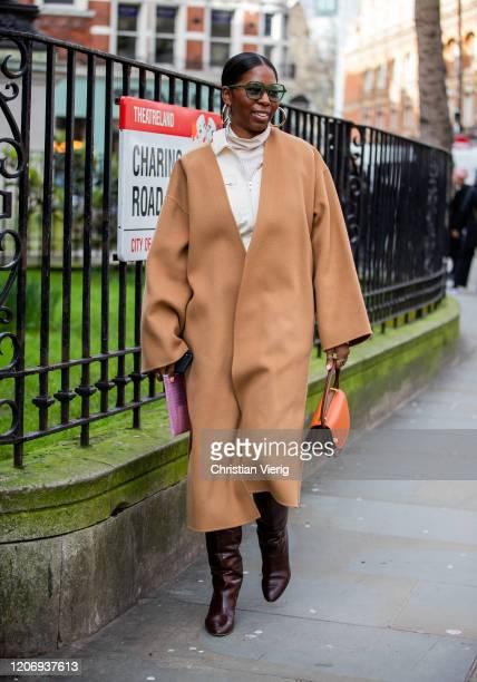 Guest is seen wearing camel coat outside Erdem during London Fashion Week February 2020 on February 17, 2020 in London, England.