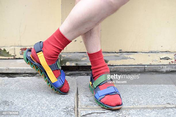 A guest is seen wearing Camper sandals before Fred Sathal show on July 6 2014 in Paris France