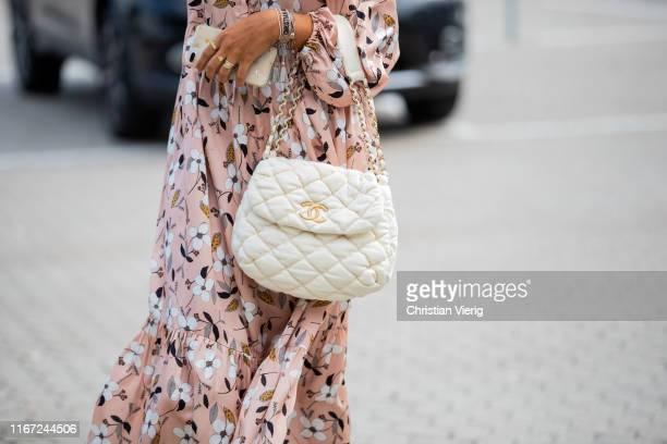 Guest is seen wearing Chanel bag outside Munthe during Copenhagen Fashion Week Spring/Summer 2020 on August 07, 2019 in Copenhagen, Denmark.