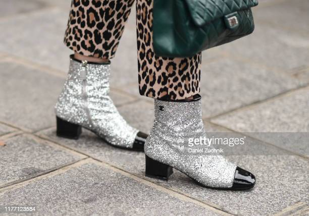 Guest is seen wearing Chanel boots outside the Unravel show during Paris Fashion Week SS20 on September 25, 2019 in Paris, France.