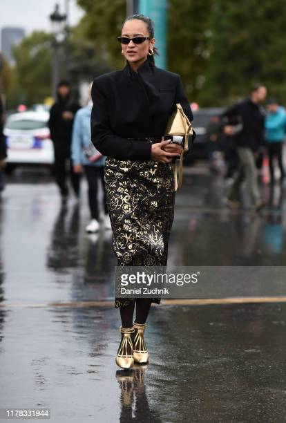 A guest is seen wearing Chanel outside the Chanel show during Paris Fashion Week SS20 on October 1 2019 in Paris France