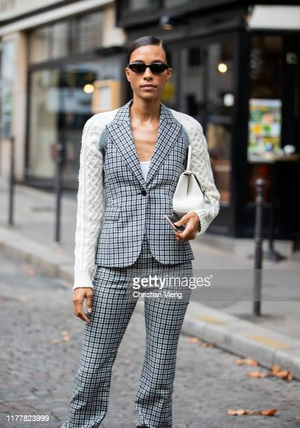 A guest is seen wearing checkered pants and two tone knited blazer outside Altuzarra during Paris Fashion Week Womenswear Spring Summer 2020 on...