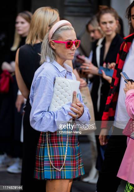 Guest is seen wearing checkered skirt, blouse, white bag, hair loop, red sunglasses outside Roberta Einer during London Fashion Week September 2019...
