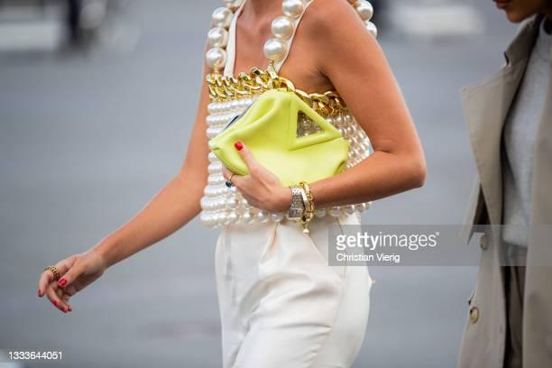 Guest is seen wearing clutchoutside Mother of Pearl on August 11, 2021 in Copenhagen, Denmark.