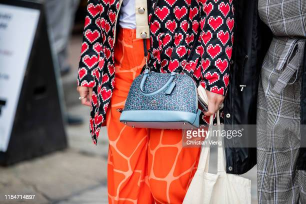 Guest is seen wearing Coach bag during London Fashion Week Men's June 2019 on June 08, 2019 in London, England.