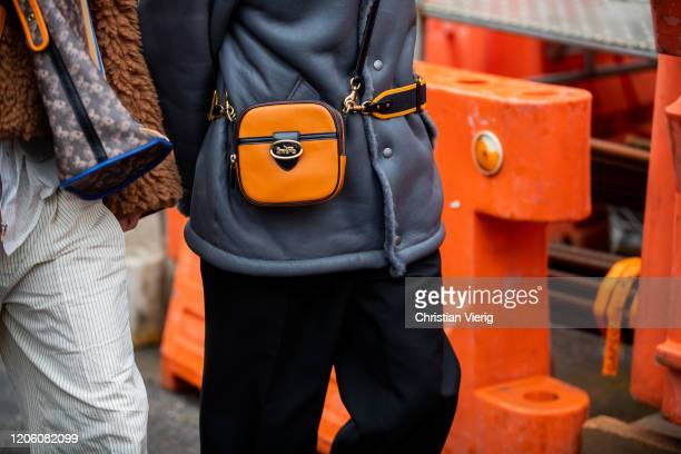 Guest is seen wearing Coach bag outside Coach during New York Fashion Week Fall / Winter on February 11, 2020 in New York City.