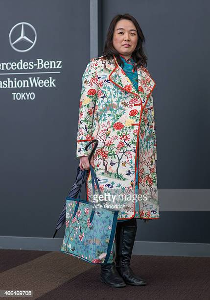 A guest is seen wearing coat and carrying bag by Keita MURIYAMA during the Mercedes Benz Fashion Week TOKYO 2015 A/W at Shibuya Hikarie on March 16...