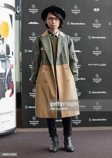 A guest is seen wearing coat by Style Nanda of Korea shirt by Kenzo tshirt by Uniqlo hat by CA4LA jeans by Top Man and shoes by Yves Saint Laurent...