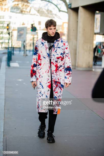 Guest is seen wearing coat with print outside Lanvin during Paris Fashion Week - Menswear F/W 2020-2021 on January 19, 2020 in Paris, France.