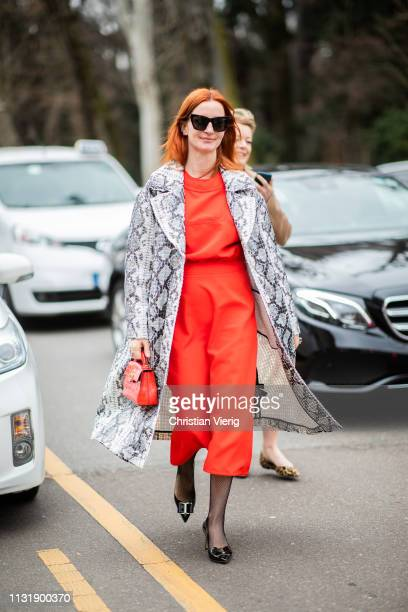A guest is seen wearing coat with snake print outside Roberto Cavalli on Day 4 Milan Fashion Week Autumn/Winter 2019/20 on February 23 2019 in Milan...