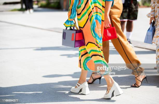 Guest is seen wearing colorful bag and dress outside Freya Dalsjø during Copenhagen Fashion Week Spring/Summer 2020 on August 07, 2019 in Copenhagen,...